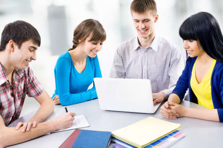 Young students studying together in a classroom Stock Photo - 14858318