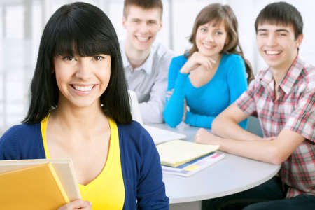 studygroup: Pretty asian girl student and her friends on background Stock Photo