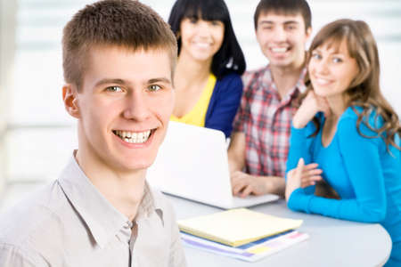 studygroup: Happy student and his friends on background Stock Photo