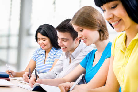 Young students studying together in a classroom Stock Photo - 14858259