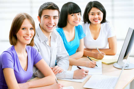Young students looking at camera and smiling Stock Photo - 14858339