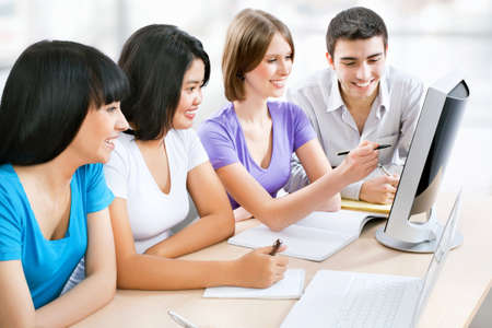 Young female students working together in classroom Stock Photo - 14858293