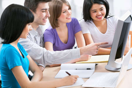 hispanic students: Happy group of young students studying together in a college