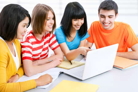 studygroup: Young students studying together with laptop