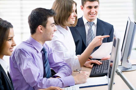Young business people working at the office photo