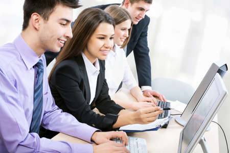 journalists: Young business people working at the office Stock Photo
