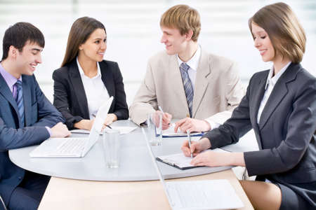 Portrait of a group of business people working together at a meeting Stock Photo