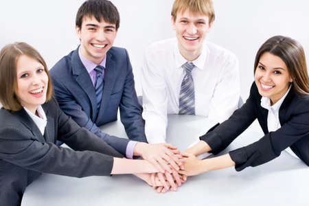 joining hands: Top view of happy business team with their hands together gesturing unity