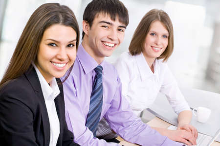 life partner: Group of business people looking at camera