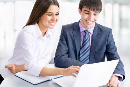 tehnology: Young business people working with laptop