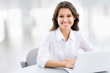 working woman: Business woman working on laptop at office Stock Photo