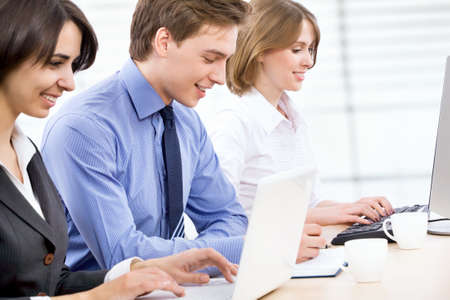 Business people working in modern office photo