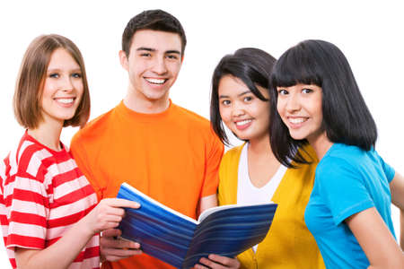 Happy young teenager students standing and smiling with book photo