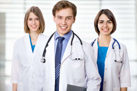 Attractive doctor with his young colleagues photo