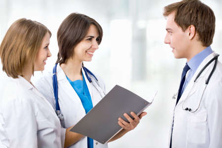 Young doctor and his colleagues Stock Photo - 15115506