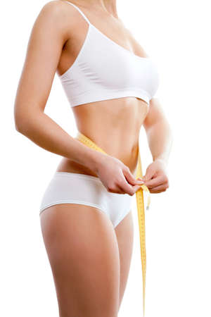 Beautiful sporty woman body with yellow measure on white background