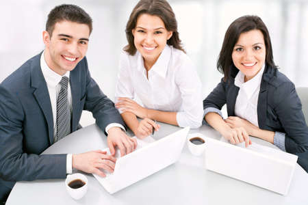 happy client: Business people. Business team working on their business project together at office. Stock Photo