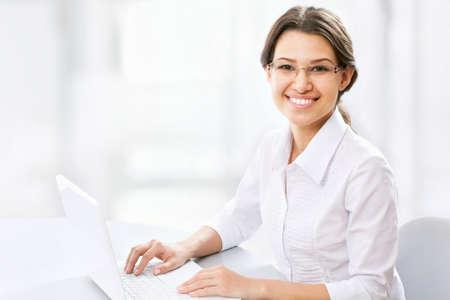 Beautiful business woman working at lapnop photo