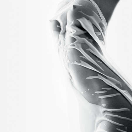 erotic dress: Beautiful female body in a tight wet tissue. The concept of beauty Stock Photo
