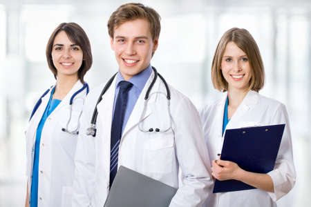 clinical staff: Attractive doctor with his young colleagues Stock Photo