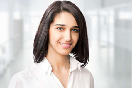 female face closeup: Portrait of cute young business woman smiling