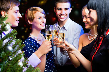 Portrait of several friends celebrating New Year