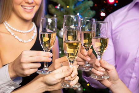 toasting wine: Image of people hands with crystal glasses full of champagne Stock Photo