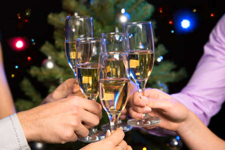 bubbly: Image of people hands with crystal glasses full of champagne Stock Photo