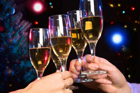 cheers: Image of people hands with crystal glasses full of champagne Stock Photo