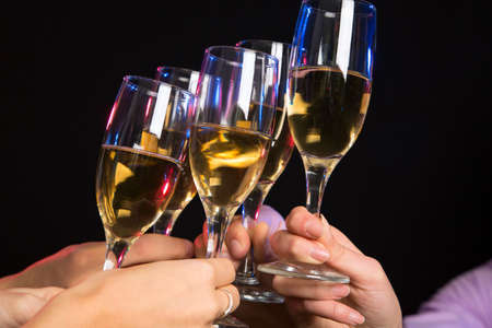 clinking: Photo of champagne glasses during toast at party