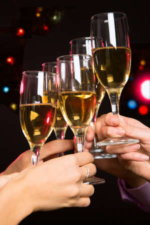 christmas drink: Happy Christmas. Image of people hands with crystal glasses full of champagne Stock Photo