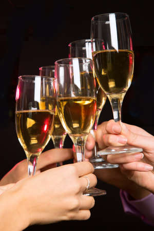 Image of people hands with crystal glasses full of champagne photo
