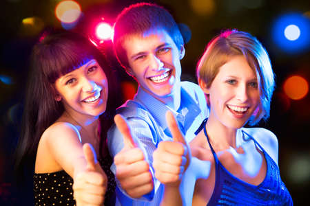 teen dance: Happy group of friends with thumbs up