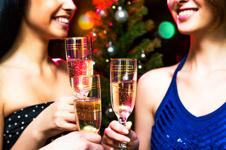 christmas drink: Happy people relaxing together at party