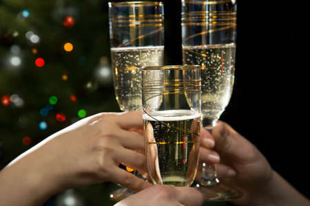 festive occasions: Happy Christmas. Image of people hands with crystal glasses full of champagne Stock Photo