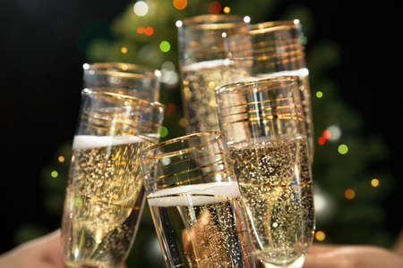 holiday gathering: Image of people hands with crystal glasses full of champagne Stock Photo