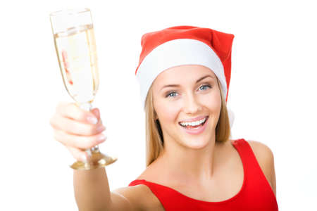 Christmas woman beautiful smiling with glass of champagne santas hat isolated on white background photo