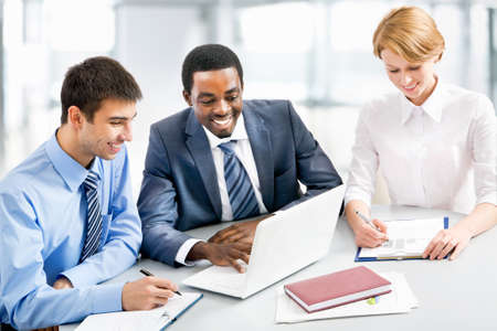 people interacting: Image of businesspeople working at meeting Stock Photo