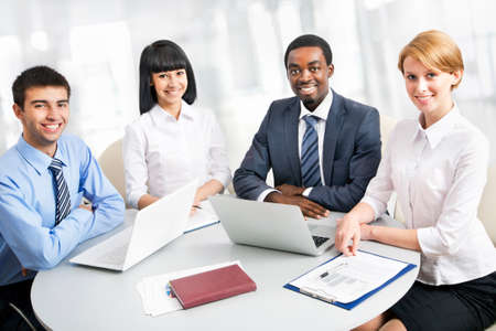 Business people working together. A diverse work group. Stock Photo - 16113318