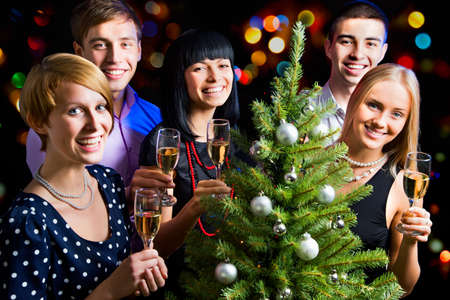 champagne toast: Portrait of happy friends wishing you Merry Christmas