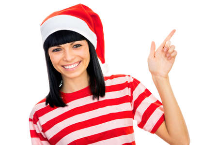 Santa girl wearing Christmas Chat and shows a white space photo