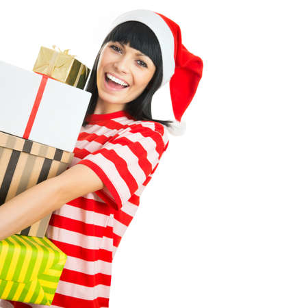 happy shopper: Santa hat Christmas woman holding christmas gifts smiling happy and excited. Stock Photo