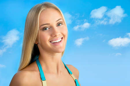 woman bathing: Beautiful woman smiling on a background of blue sky