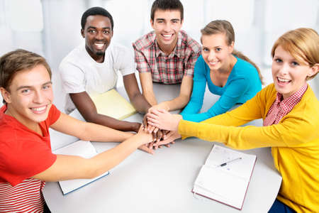 japanes: International group of students showing unity with their hands together Stock Photo
