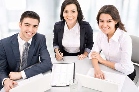 businessteamwork: Group of business people smiling in an office