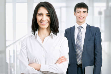 Business woman standing in front of her colleague Stock Photo - 17516807