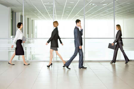 Business people walking in the office corridor Stock Photo - 17516598