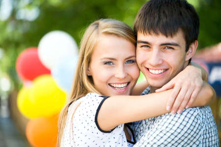 Attractive young woman embracing her handsome boyfrend photo