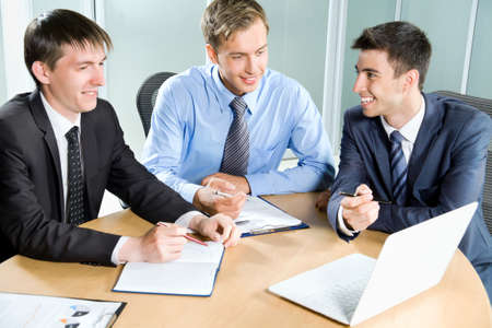 financial planner: Business people. Business team working on their business project together at office. Stock Photo