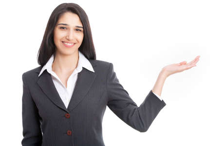 Portrait of young business woman pointing at white background photo